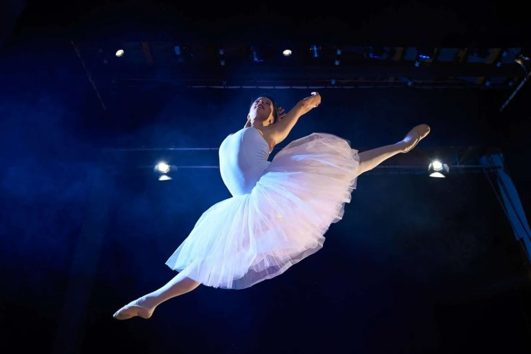 13615146_female-classic-dancer-jumping-mid-air-during-ballet