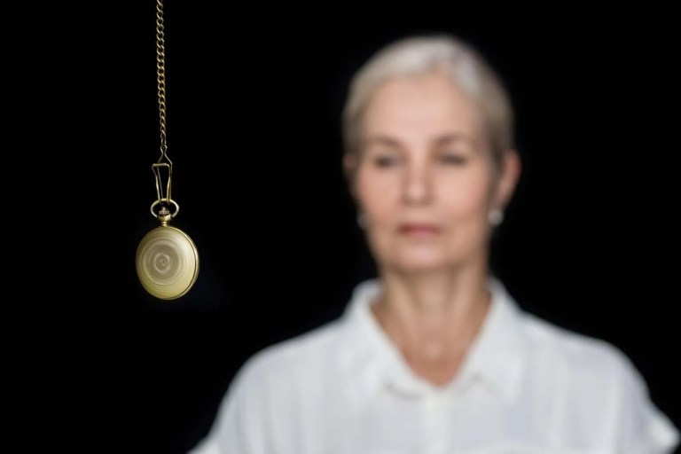 29236536_woman-being-hypnotized-with-pendulum