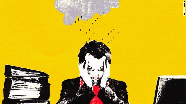 Rainy cloud over unwell businessman in office