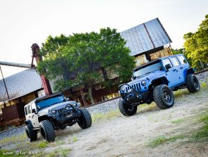 Sprayed Blue Jeep Rubicon and Grey Jeep Front View