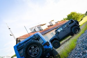 Sprayed Blue Jeep Rubicon Read View and Grey Jeep Drivers Side View