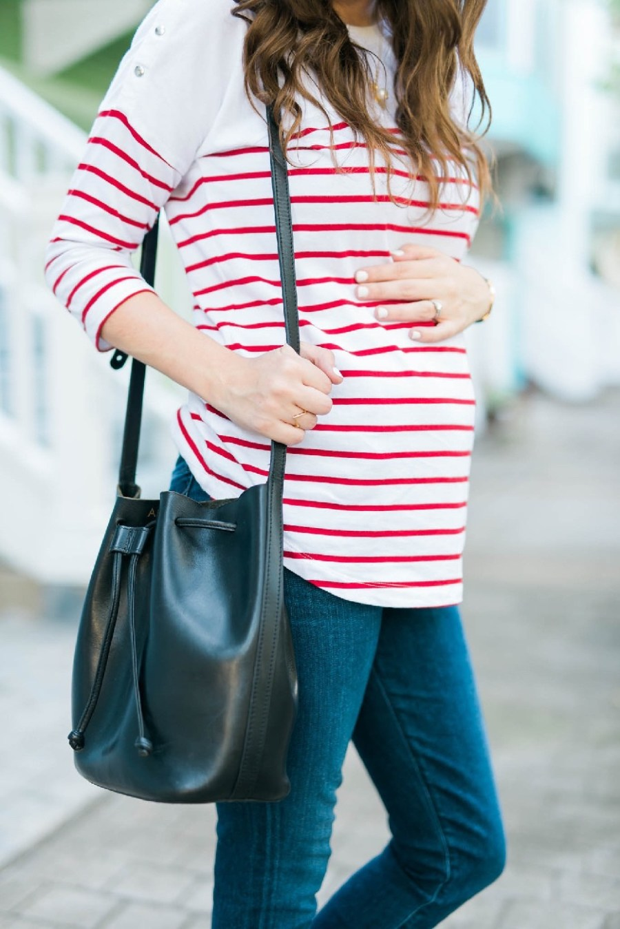 Red striped maternity top from Seraphine Maternity with a black Mark & Graham bucket bag.