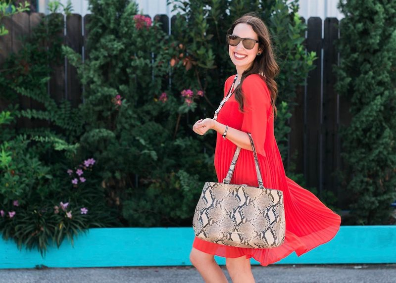 Maternity outfit inspiration with a red dress and snake print accessories.