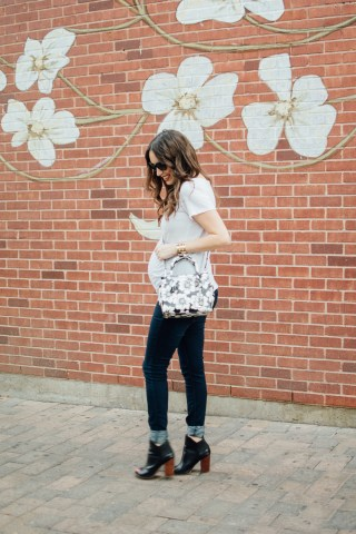 Texas fashion blogger Lone Star Looking Glass shares maternity outfit inspiration in a white tee, jeans and a Kate Spade Floral Handbag.