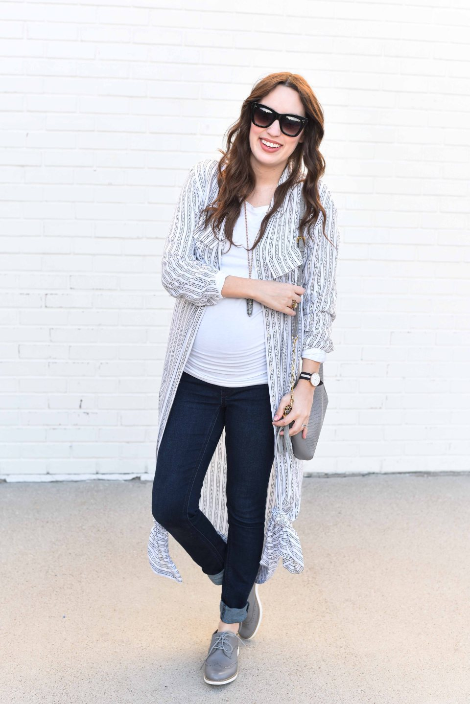 Fashion Blogger Alice Kerley styles a Planet Blue Button Down Dress over a tee and jeans for an easy maternity outfit.