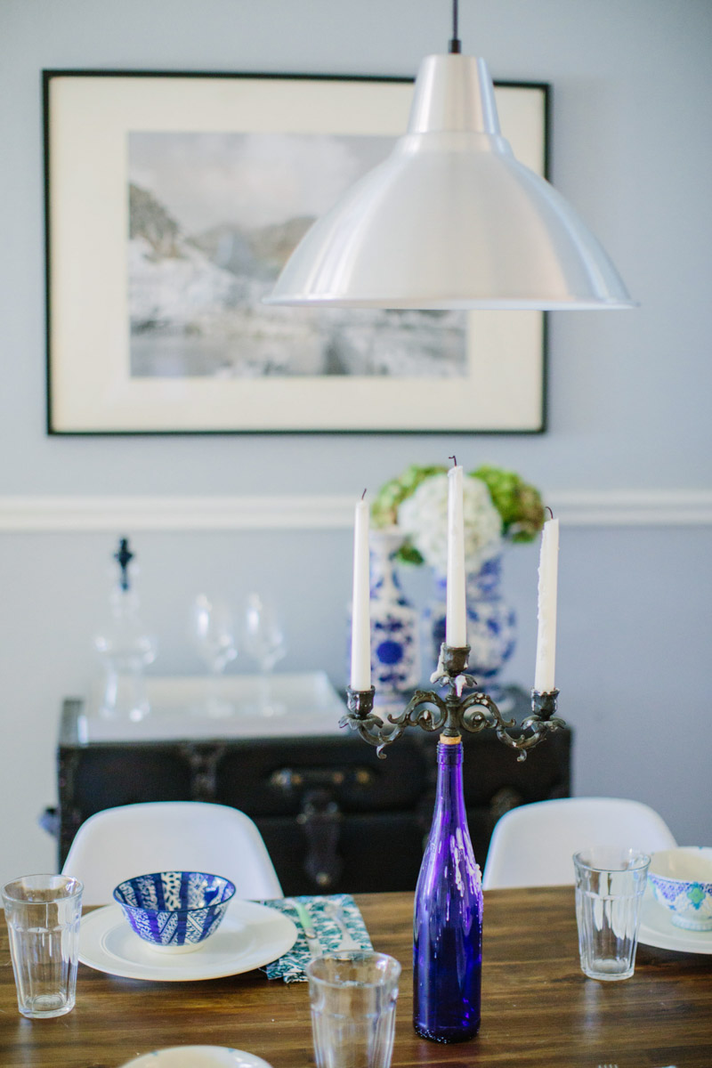 Using a black trunk as a bar and topping it off with blue and white vases filled with hydrangeas.