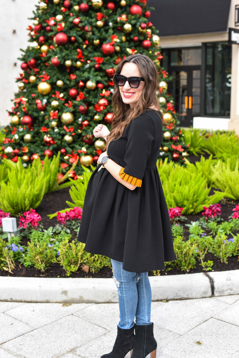 Houston fashion blogger styles a black zara peplum top with citizen maternity skinny jeans and sole society ankle boots for the holidays.