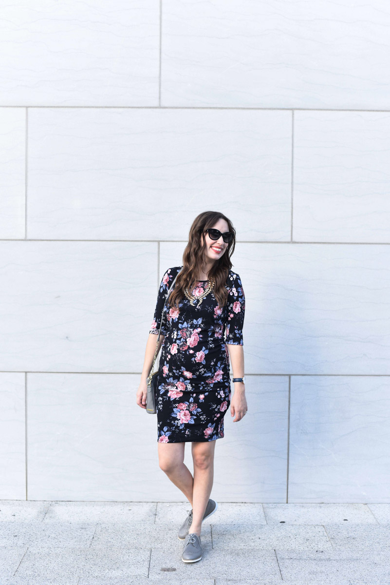 Houston fashion blogger Alice Kerley styles PinkBlush's black and floral fitted maternity dress with gray accessories for fall.
