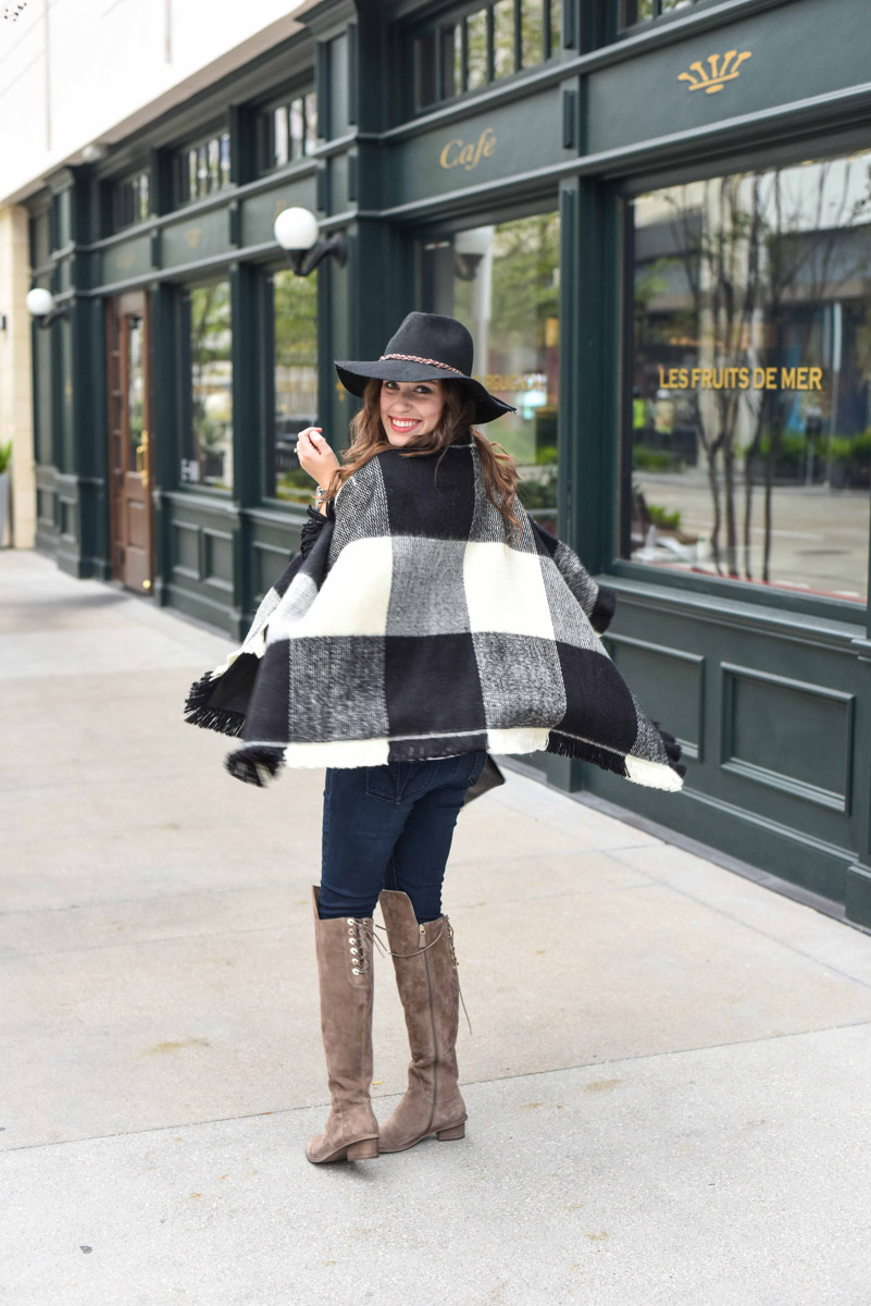 Texas blogger Alice Kerley shares fall outfit inspiration in a Tularosa plaid poncho and Elaine Turner Over the Knee Boots.