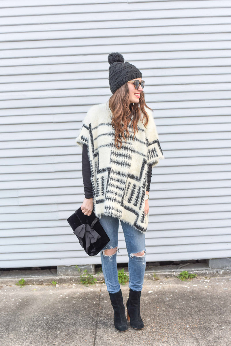 Houston fashion blogger styles sole society black ankle booties with a black and white poncho for a winter maternity style outfit.