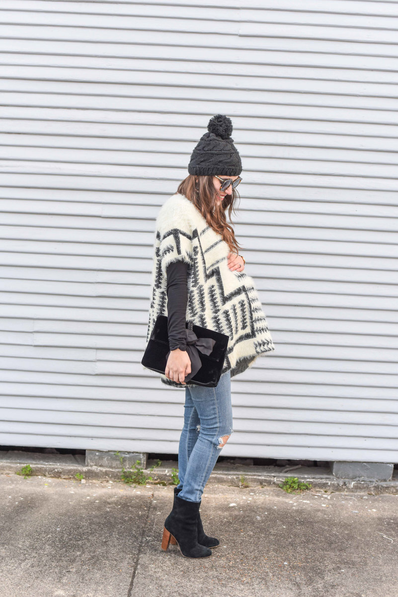 Houston fashion blogger styles a winter maternity outfit and shares a 36-week baby bump update.