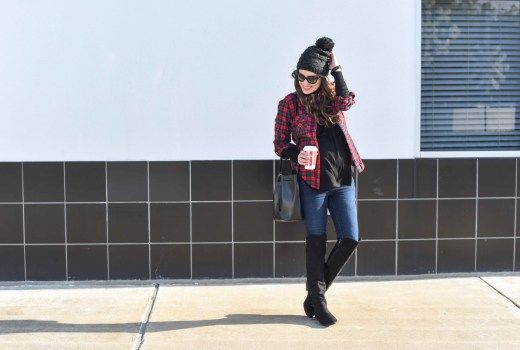 Texas fashion blogger shares maternity outfit inspiration with a red plaid top, black tee, macys over the knee boots and a beanie.