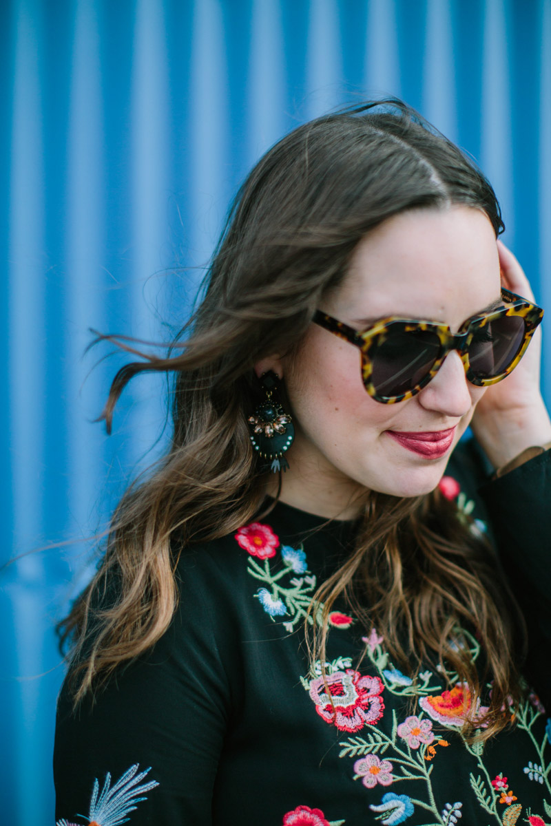 Houston fashion blogger styles black Baublebar Statement earrings with an embroidered top from Chicwish.