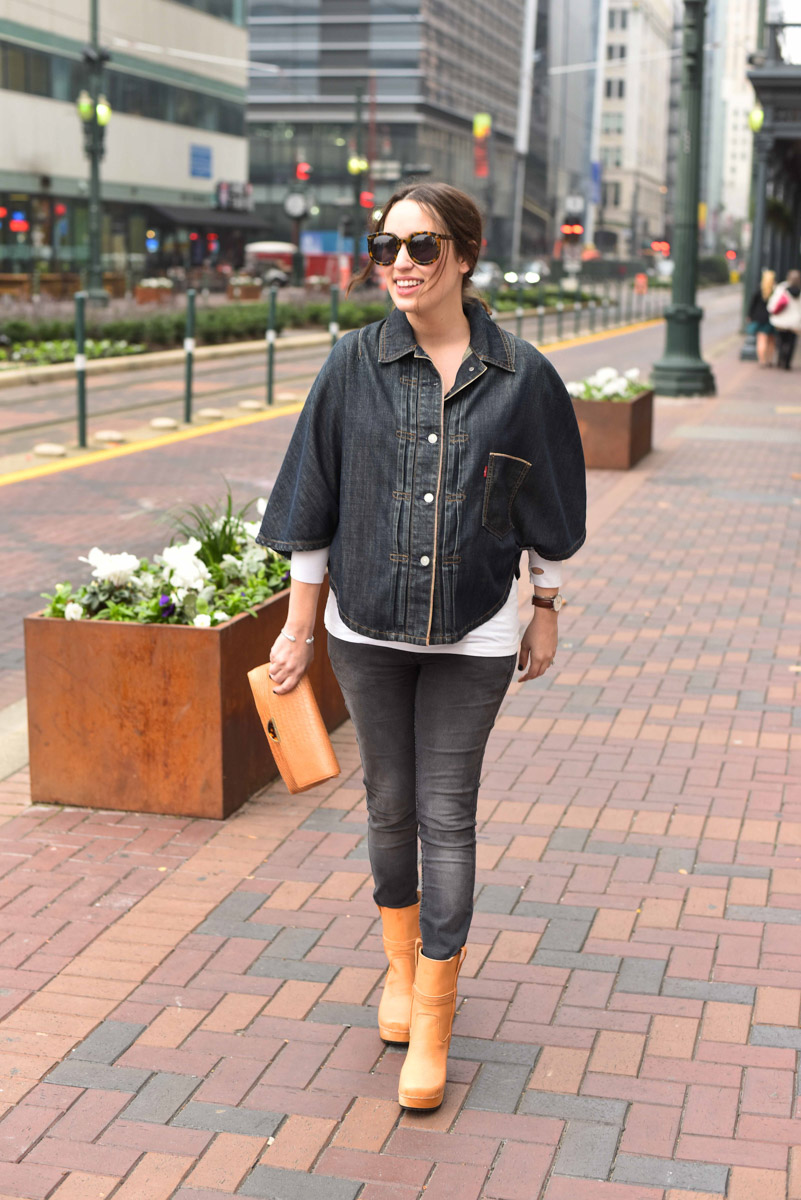 Houston fashion blogger styles her vintage levi's denim poncho with dark jeans, an elaine turner clutch and swedish hasbeens boots.