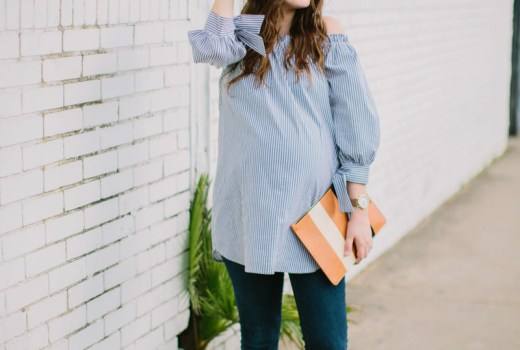 Houston fashion blogger styles an off the shoulder striped maternity top with maternity jeans, vionic lace up flats and a striped clare vivier clutch.