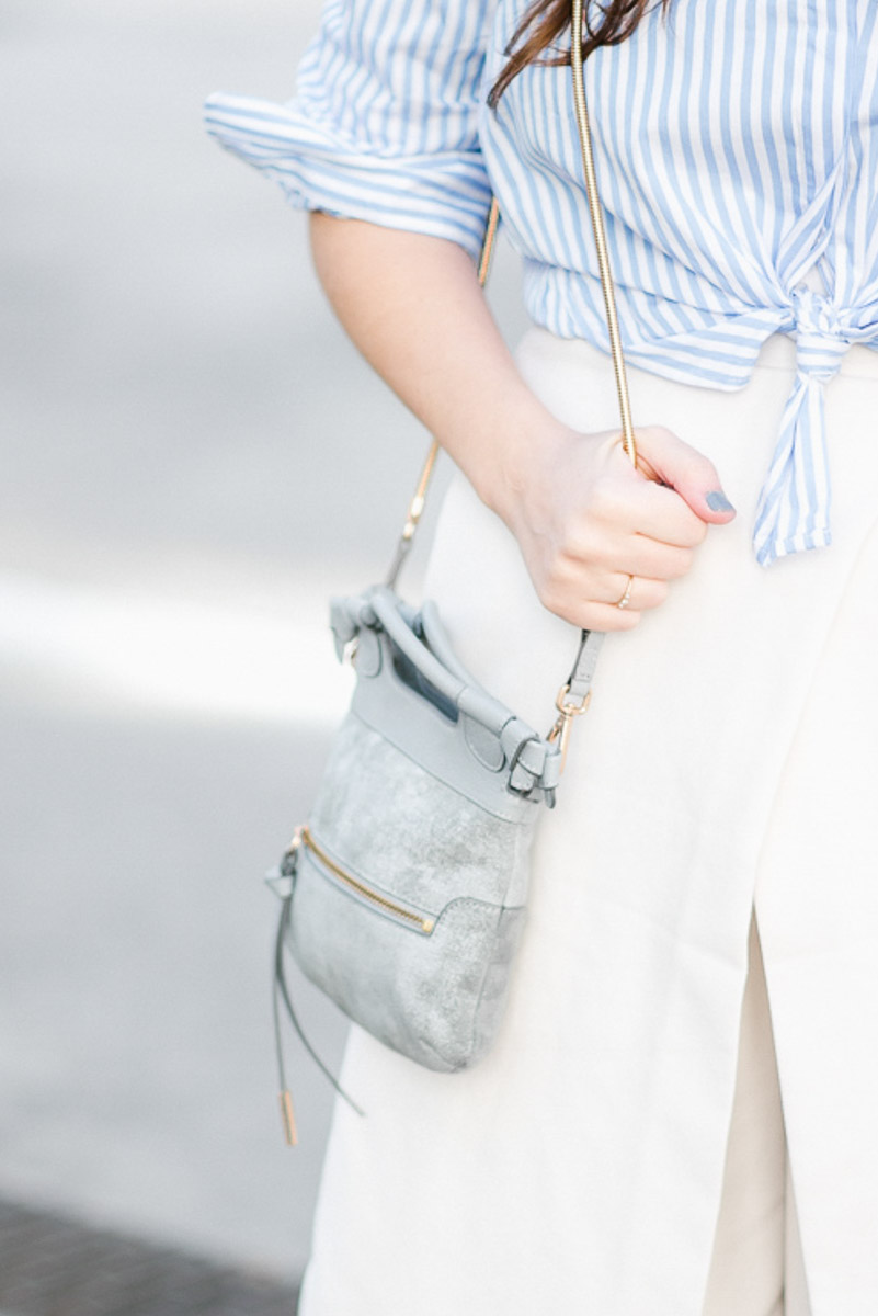 Foley and Corinna blue handbag styled with white culottes.
