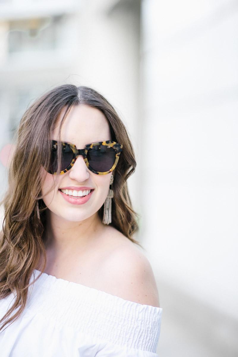 Lisi Lerch tassel earrings in silver with Karen Walker sunglasses.