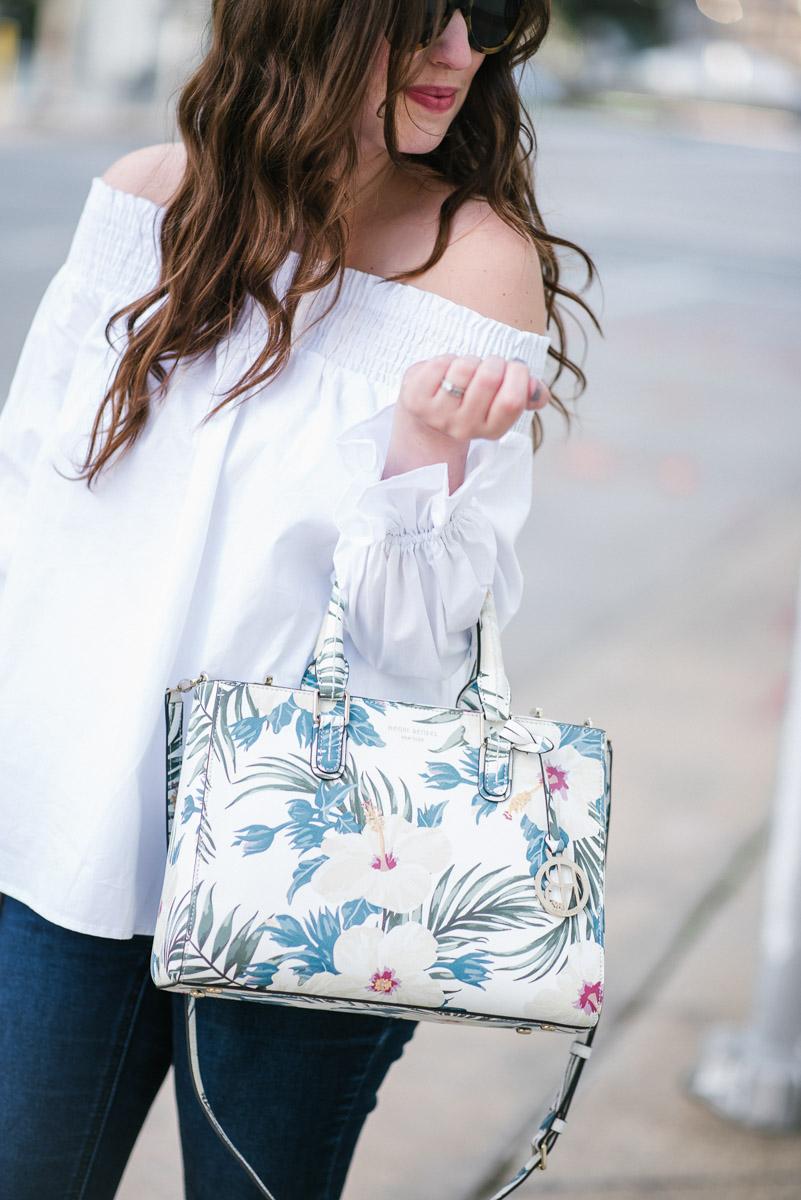 Houston fashion blogger styles a Henri Bendel floral handbag and Steve Madden wedges for spring outfit inspiration.