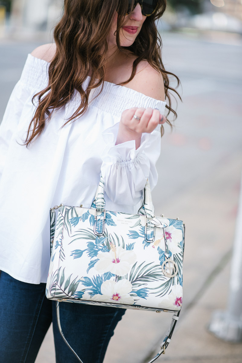 Houston fashion blogger styles a Henri Bendel floral handbag and Steve Madden wedges for spring outfit inspiration.