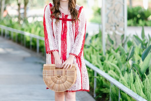 Beach outfit inspiration in Anthropologie's red pom pom Joselle dress.