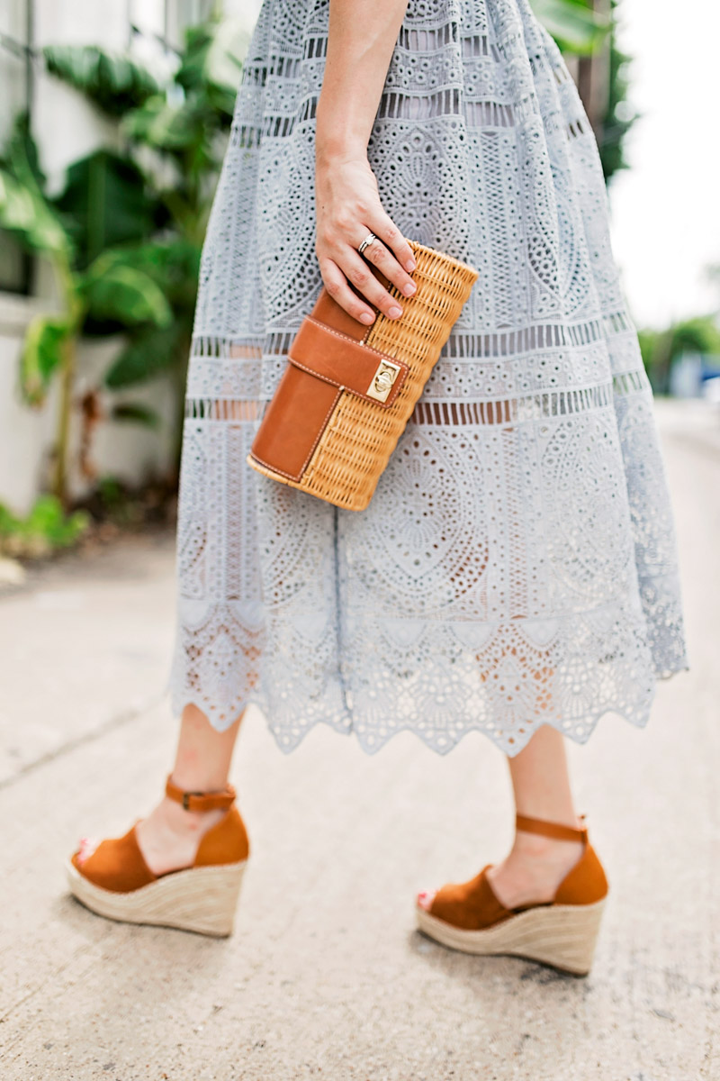 Houston fashion blogger styles a wicker clutch with Steve Madden wedges.