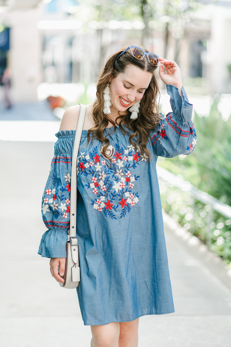 Houston fashion blogger styles a red white and blue off the shoulder dress.