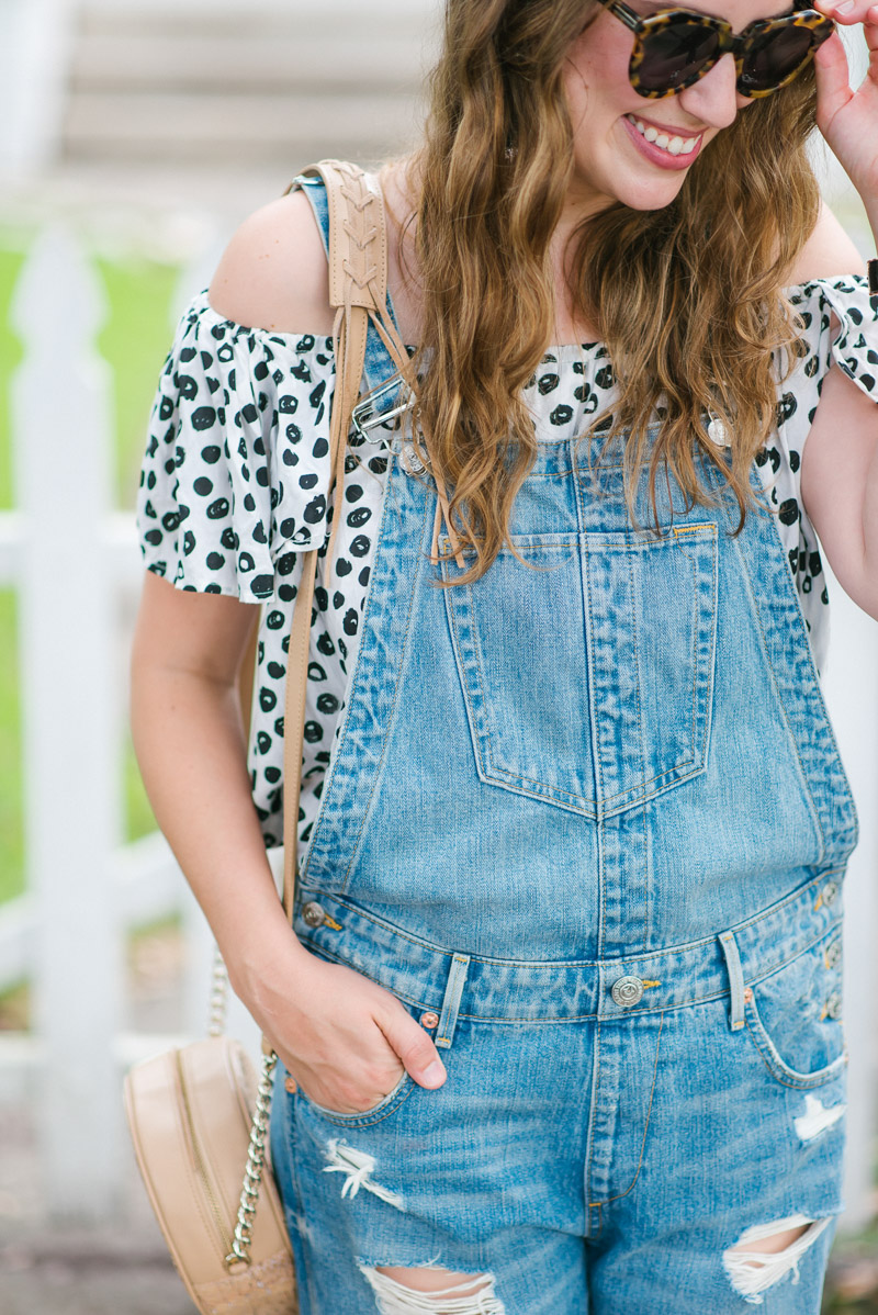 Anthropologie overalls paired with an off the shoulder polka dot top.