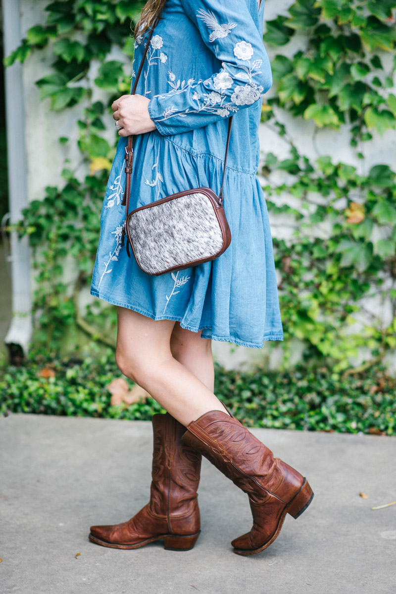 Mark and Graham calfhair camera bag paired with lucchese cowboy boots.