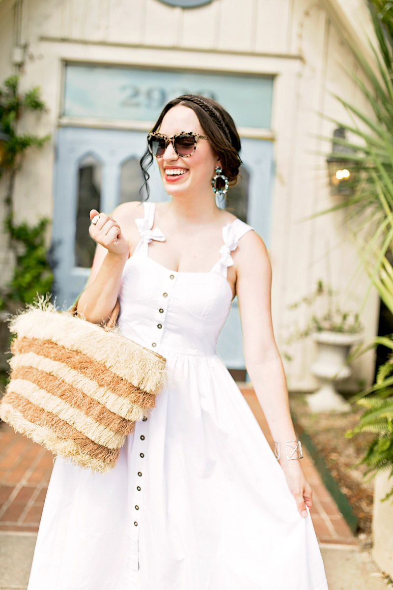 Texas blogger styles a white chichwish midi dress with a straw basket for summer.