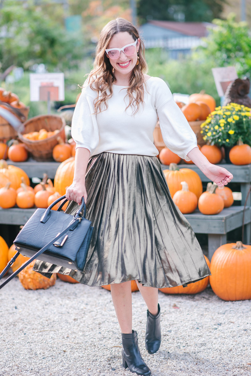 Fall Outfit Ideas in a gold Ann Taylor skirt and white sweater.