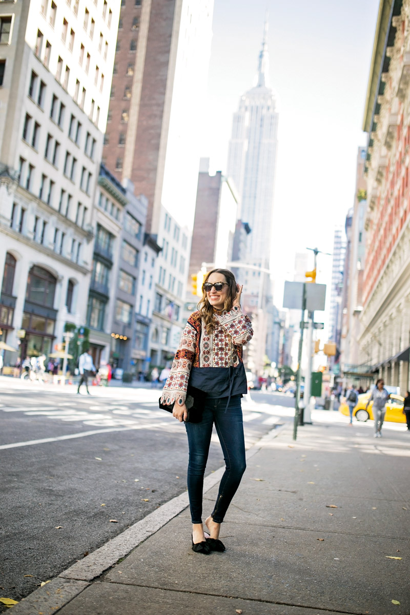 Tory Burch Boho Top paired with velvet bow heels and skinny jeans during New York Fashion Week 2018.