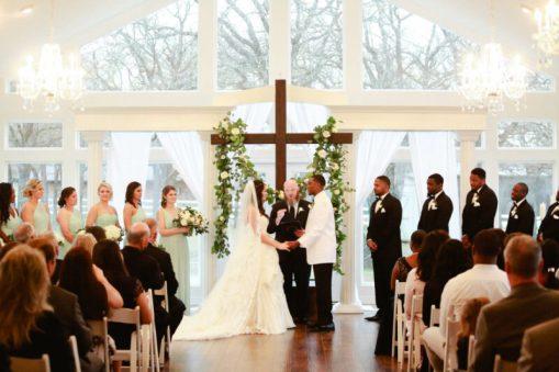 ballroom ceremony wedding party cross floral garland