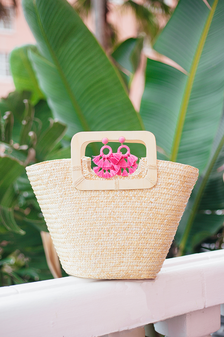 pink statement earrings, straw bag, tuckernuck, pink and palm trees, the don cesar hotel