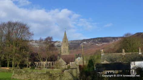 A dusting of snow on Kinder as we walk through Edale village