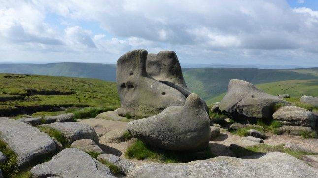 Worn gritstone on the edge path