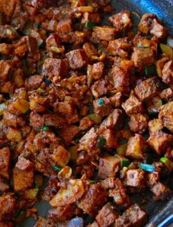 Left over steak taco filling in a cast iron skillet.