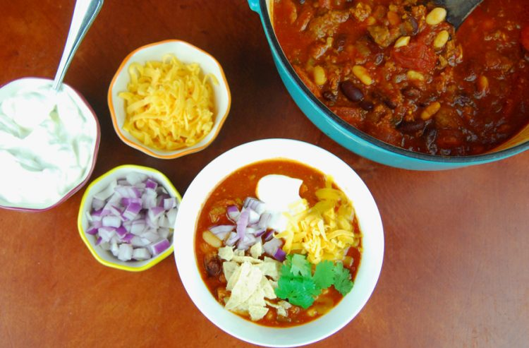 This hearty meat lover's easy chili recipe is sure to be a hit at your next family dinner. This chili is packed full of meat, beans, and tomato flavor!