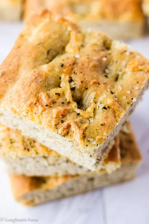 Stack of three slices of homemade focaccia recipe, top view.