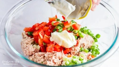 Adding mayo to the mix for easy tuna melt recipe.