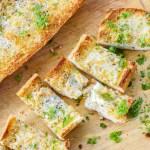 Cut slices of cheesy garlic bread recipe.
