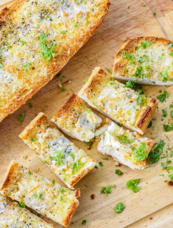 Cut slices of cheesy garlic bread recipe.
