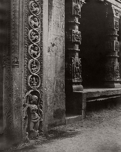 Linnaeus Tripe (British, Devonport (Plymouth Dock) 1822–1902 Devonport) Madura. Pillars in the recessed portico in the roya gopurum with the base of one of the four sculptured monoliths., January–March 1858 Lightly albumenized Salted paper print; image: 35.6 × 28.1 cm (14 × 11 1/16 in.) page size: 43.4 × 56 cm (17 1/16 × 22 1/16 in.) The Metropolitan Museum of Art, New York, (LT.BL.5) http://www.metmuseum.org/Collections/search-the-collections/643446