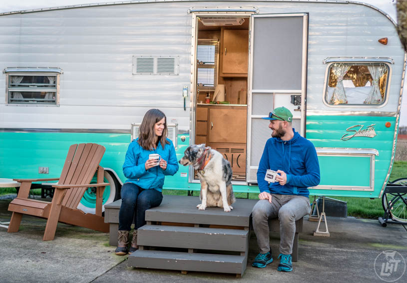 Sitting outside our vintage trailer at the Vintages