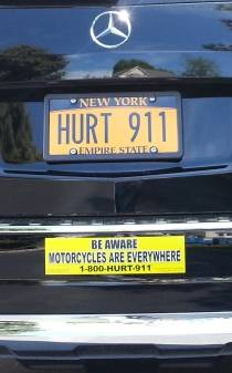 image showing Motorcycle awareness bumper sticker on Phil's car