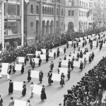 Suffragists parade down Fifth Avenue, 1917. Advocates march in October 1917, displaying placards containing the signatures of more than one million New York women demanding the vote.  The New York Times Photo Archives