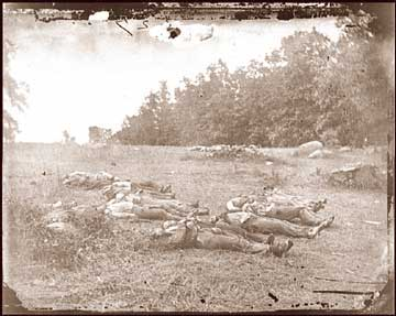 Photograph of Confederate dead in The Wheatfield, where Milo Grow's regiment fought. (Library of Congress)