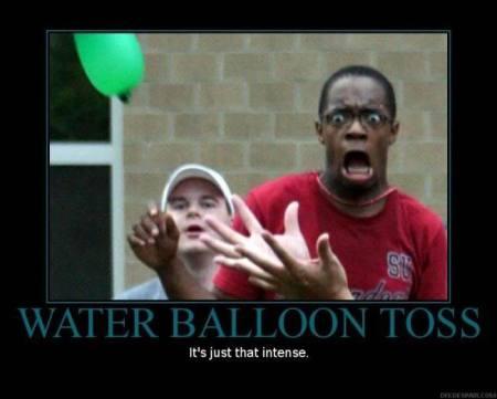 man screaming at water balloon toss