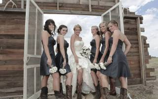 the bride and her brides maids lifting up there dress reviling there legs and cowboy boots