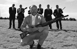 wedding photo with shot guns in all of the guys hands at longmeadow - Colorado Wedding Venue