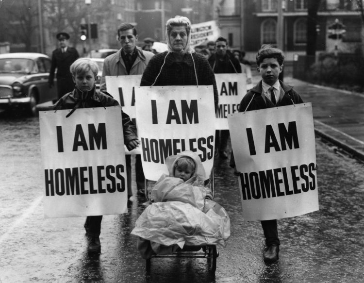 A group of people march to the home of the Minister of Housing, Sir Keith Joseph, to call for the requisitioning of some of London's empty houses. Keystone/Getty Images